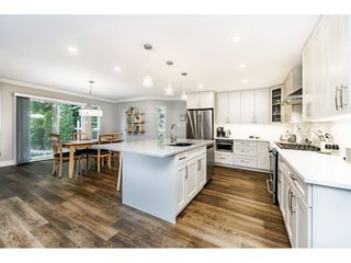 Photo 12: 3550 PEARKES Place in Port Coquitlam: Lincoln Park PQ House for sale : MLS®# R2478465