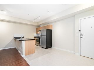 "Photo 13: 401 10092 148 Street in Surrey: Guildford Condo for sale in ""BLOOMSBURY COURT"" (North Surrey)  : MLS®# R2525835"
