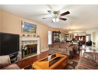 Photo 2: 637 PENDER PL in Port Coquitlam: Riverwood House for sale : MLS®# V1016018