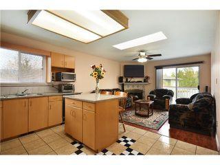 Photo 3: 637 PENDER PL in Port Coquitlam: Riverwood House for sale : MLS®# V1016018