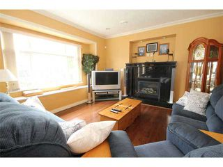 Photo 7: 5651 Earles St in Vancouver: Collingwood VE House for sale (Vancouver East)  : MLS®# V1009530