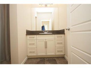 Photo 15: 374 FIRESIDE Place: Cochrane House for sale : MLS®# C3651401