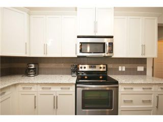 Photo 7: 374 FIRESIDE Place: Cochrane House for sale : MLS®# C3651401