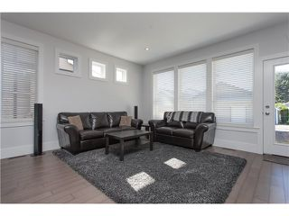 Photo 7: 34674 3RD Avenue in Abbotsford: Poplar House for sale : MLS®# F1448312