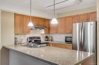 """Photo 7: 111 2373 ATKINS Avenue in Port Coquitlam: Central Pt Coquitlam Condo for sale in """"Carmandy"""" : MLS®# R2146950"""