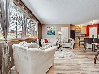 Photo 2: 101 15 EVERRIDGE Square SW in Calgary: Evergreen House for sale : MLS®# C4131530