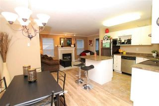 "Photo 3: 205 33502 GEORGE FERGUSON Way in Abbotsford: Central Abbotsford Condo for sale in ""Carina Court"" : MLS®# R2215286"