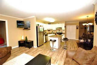 "Photo 4: 205 33502 GEORGE FERGUSON Way in Abbotsford: Central Abbotsford Condo for sale in ""Carina Court"" : MLS®# R2215286"
