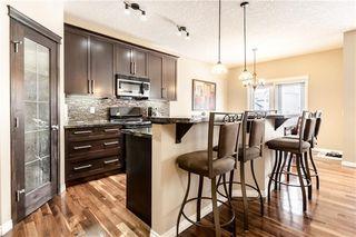 Photo 6: 325 BRIDLERIDGE View SW in Calgary: Bridlewood House for sale : MLS®# C4177139