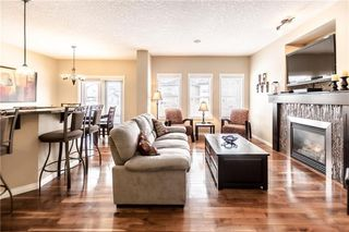 Photo 11: 325 BRIDLERIDGE View SW in Calgary: Bridlewood House for sale : MLS®# C4177139