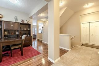 Photo 2: 325 BRIDLERIDGE View SW in Calgary: Bridlewood House for sale : MLS®# C4177139