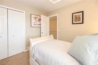 Photo 17: 325 BRIDLERIDGE View SW in Calgary: Bridlewood House for sale : MLS®# C4177139
