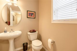 Photo 4: 325 BRIDLERIDGE View SW in Calgary: Bridlewood House for sale : MLS®# C4177139