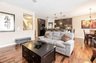 Photo 8: 325 BRIDLERIDGE View SW in Calgary: Bridlewood House for sale : MLS®# C4177139