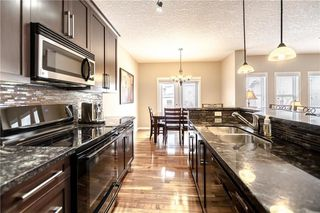 Photo 7: 325 BRIDLERIDGE View SW in Calgary: Bridlewood House for sale : MLS®# C4177139