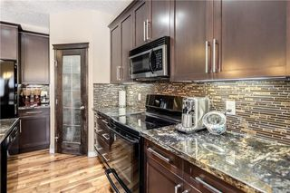 Photo 10: 325 BRIDLERIDGE View SW in Calgary: Bridlewood House for sale : MLS®# C4177139
