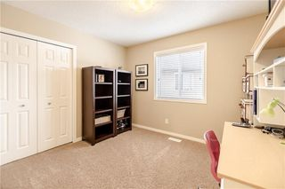 Photo 18: 325 BRIDLERIDGE View SW in Calgary: Bridlewood House for sale : MLS®# C4177139