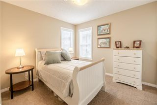 Photo 16: 325 BRIDLERIDGE View SW in Calgary: Bridlewood House for sale : MLS®# C4177139