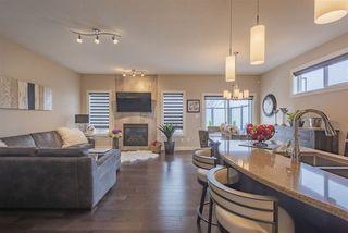 Photo 1: 4 4517 190A Street in Edmonton: Zone 20 House Half Duplex for sale : MLS®# E4148800
