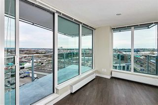 "Photo 3: 702 489 INTERURBAN Way in Vancouver: Marpole Condo for sale in ""MARINE GATEWAY"" (Vancouver West)  : MLS®# R2355019"