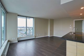 "Photo 4: 702 489 INTERURBAN Way in Vancouver: Marpole Condo for sale in ""MARINE GATEWAY"" (Vancouver West)  : MLS®# R2355019"
