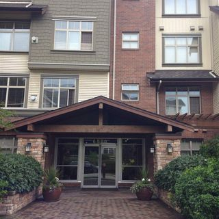 """Photo 1: 216 6500 194 Street in Surrey: Clayton Condo for sale in """"Sunset Grove"""" (Cloverdale)  : MLS®# R2091324"""