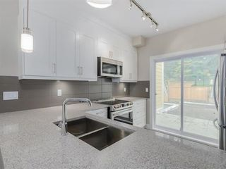 """Photo 6: 107 1405 DAYTON Avenue in Coquitlam: Burke Mountain Townhouse for sale in """"ERICA"""" : MLS®# R2104170"""