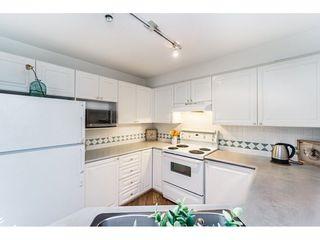 """Photo 14: 426 15268 105 Avenue in Surrey: Guildford Condo for sale in """"Georgian Gardens"""" (North Surrey)  : MLS®# R2243347"""