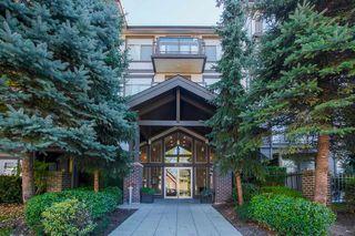 Photo 1: 418 15322 101 Avenue in Surrey: Guildford Condo for sale (North Surrey)  : MLS®# R2305760