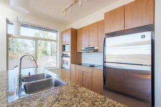 Photo 8: 418 15322 101 Avenue in Surrey: Guildford Condo for sale (North Surrey)  : MLS®# R2305760
