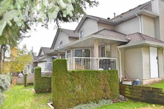 "Photo 1: 410 13900 HYLAND Road in Surrey: East Newton Townhouse for sale in ""Hyland Grove"" : MLS®# R2342977"