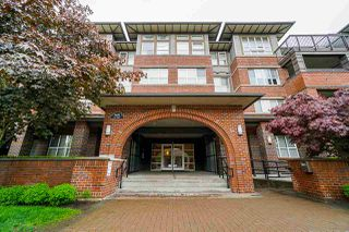 """Photo 1: 304 6815 188 Street in Surrey: Clayton Condo for sale in """"COMPASS"""" (Cloverdale)  : MLS®# R2370140"""