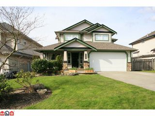 "Photo 1: 18127 68TH Avenue in Surrey: Cloverdale BC House for sale in ""Cloverwoods"" (Cloverdale)  : MLS®# F1109523"