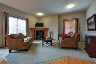 Photo 2: 108 100 COOPERS Common SW: Airdrie Residential Attached for sale : MLS®# C3596213
