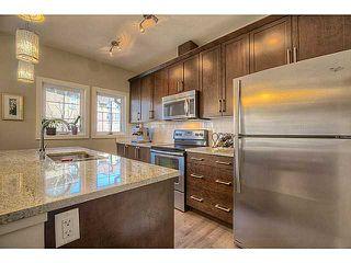 Photo 3: 435 Quarry Villa SE in : Quarry Park Townhouse for sale (Calgary)  : MLS®# C3615152