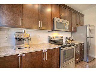 Photo 4: 435 Quarry Villa SE in : Quarry Park Townhouse for sale (Calgary)  : MLS®# C3615152