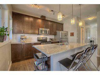 Photo 2: 435 Quarry Villa SE in : Quarry Park Townhouse for sale (Calgary)  : MLS®# C3615152