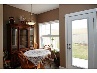Photo 9: 245 RANCH RIDGE Meadows: Strathmore Townhouse for sale : MLS®# C3615774