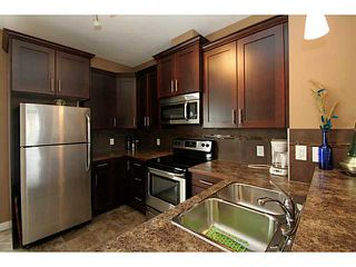 Photo 3: 245 RANCH RIDGE Meadows: Strathmore Townhouse for sale : MLS®# C3615774