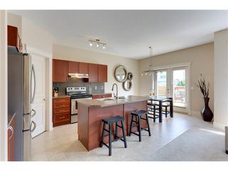 Photo 8: 257 COUGARTOWN Circle SW in Calgary: Cougar Ridge House for sale : MLS®# C4025299
