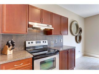 Photo 12: 257 COUGARTOWN Circle SW in Calgary: Cougar Ridge House for sale : MLS®# C4025299