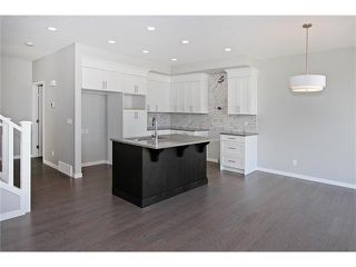 Photo 11: 158 WALGROVE Drive SE in Calgary: Walden House for sale : MLS®# C4075055