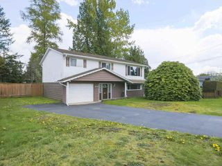 "Photo 1: 4050 WELLINGTON Street in Port Coquitlam: Oxford Heights House for sale in ""OXFORD HEIGHTS"" : MLS®# R2365270"