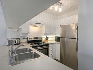 """Photo 1: 408 135 ELEVENTH Street in New Westminster: Uptown NW Condo for sale in """"QUEENS TERRACE"""" : MLS®# R2445118"""