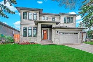 Photo 1: 2704 LIONEL Crescent SW in Calgary: Lakeview Detached for sale : MLS®# C4297137