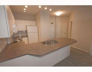 Photo 6: 150 - 3000 Marda Link SW in Calgary: Garrison Woods Condo for sale : MLS®# C3409573