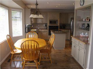"Photo 7: 22 BRACKENRIDGE Place in Port Moody: Heritage Mountain House for sale in ""HERITAGE MOUNTAIN"" : MLS®# V1056517"