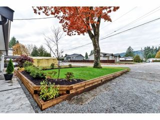 Photo 2: 732 BRADA Drive in Coquitlam: Coquitlam West House Duplex for sale : MLS®# V1093144