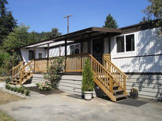 "Photo 1: 18 9960 WILSON Road in Mission: Stave Falls Manufactured Home for sale in ""Ruskin Park Place"" : MLS®# R2328906"