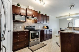 Photo 3: 81 ROYAL CREST View NW in Calgary: Royal Oak Semi Detached for sale : MLS®# C4253353